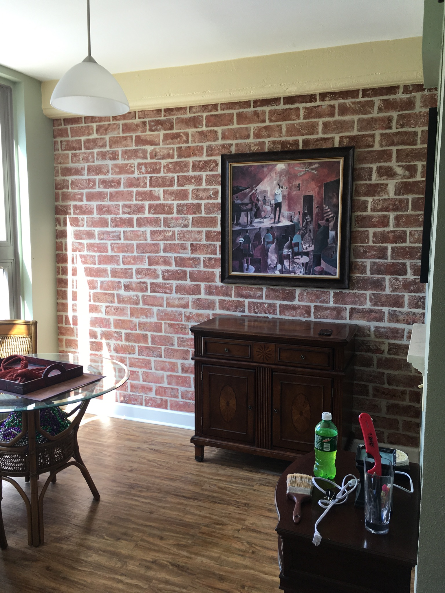 Faux Brick Wall… Staging a Warehouse District Condo with Art!